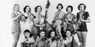 Vintage photo of ten female musicians with their instruments